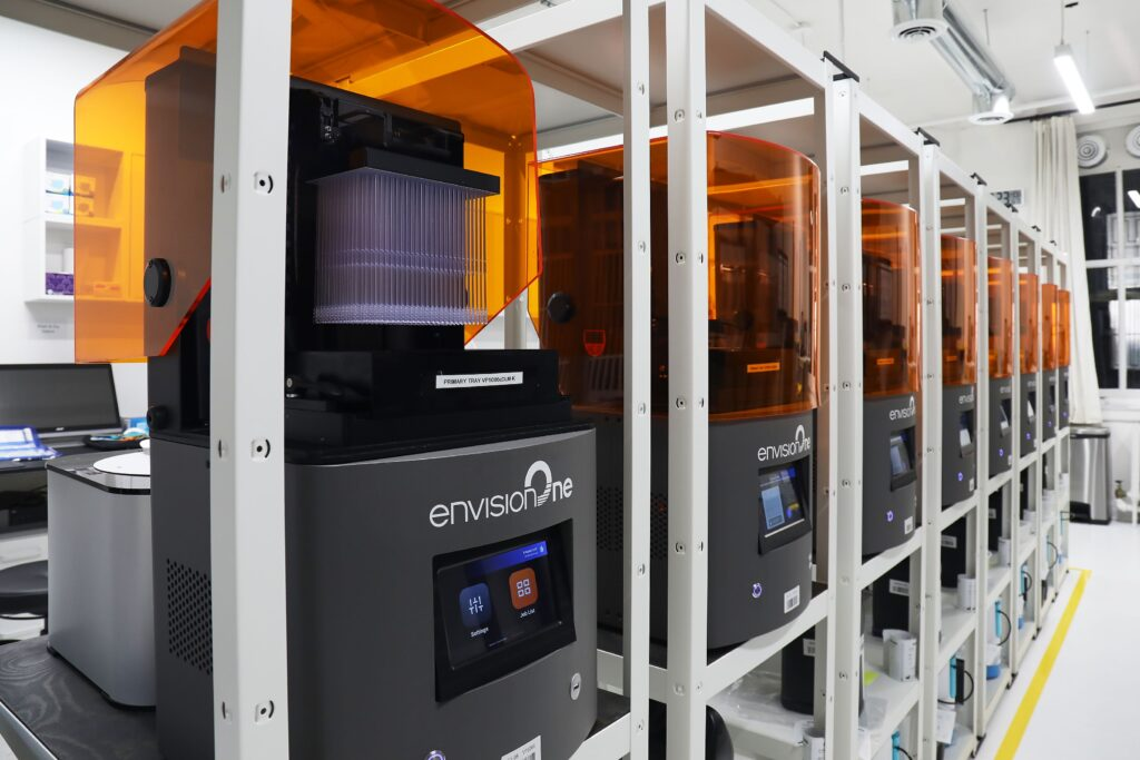 Machines printing parts in row